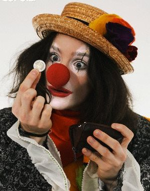 Clown holding coin --- Image by © Fancy/Veer/Corbis